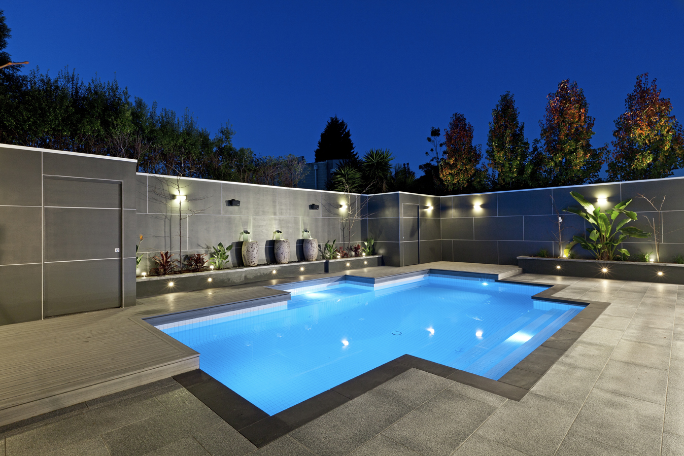Interesting Backyard Small Swimming Pool With Elegant Gray Gate Surrounding  The Pool Also Fresh Granite Paving
