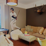 interesting boys teen lounge with gorogeus brown and cream accent and wonderful baseball player wall painting feat masculine guitar and wonderful pendant lamp in brown carpeting