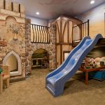 interesting bsement playroom for kids with a sliding entry way also forogeus wooden stone wall and ravishing small chair in large carpeting