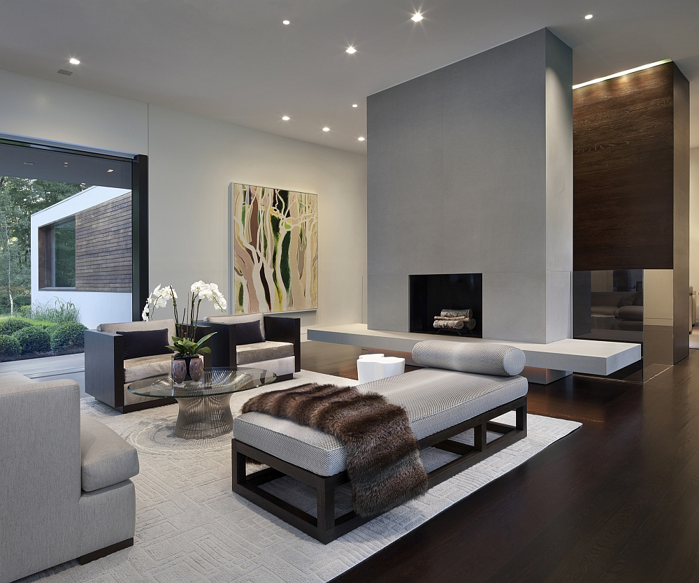 Interesting Living Room Area With Glass Top Table And Cute Fur Cover Elegant Grey Hues
