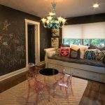 interesting room for kids with brilliant chalkboard wall and ravishing wooden couch also crystal chandelier with small set of cahir and table in hard wooden flooring