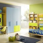 interesting teenage girl bedrrom with fresh green painted wall also cute blue bed with beautiful wooden cabinet also interesting small storage in laminate flooring concept