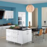 light blue painted wall pale white ceramic tiled floor white kitchen cabinets black countertops beautiful pendant lamp shade wooden dining chair dark wooden dining table colorful kitchen design ideas