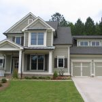 light gray painted house beautiful farmhouse design white painted window and door frame gray roof light gray garage door well groomed frontyard color for house exterior