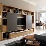 light wood TV cabinet light wood property racks light wood book shelves grey TV sliding door white marble tile soft grey sofa black square table brown leather carpet luxurious black chairs square light w