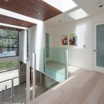 light wooden floor creame painted wall creame painted ceiling large glass window wooden panel ceiling large glassed window glassed door  contemporary villa design in Malibu