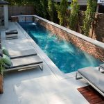 long and slender lap pool stony pool side porcelain tiled floor wooden enclosures cozy outdoor chairs small swimming pool idea