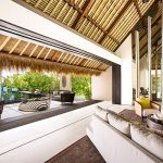 Luxurious Accomodation In Maldive With Cozy Long Couch And Wonderful Round Coffee Table And Unqie Sloping Ceiling Idea With Beautfiul Ocean View