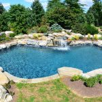 magnificent ingorud swimming pool with gorgeous stone paving concept also interesting stone waterfall and interesting garden concept