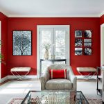 magnificent red and white living room with interesting flower patter sofa and elegant glass table also gorgeous wall art painting in large carpet flooring