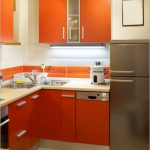 orange painted cabinets white and orang cerammic tiled backsplash creame marble kitchen countertop creame ceramic tiled floor two doores steeled refrigerator colorful kitchen design ideas