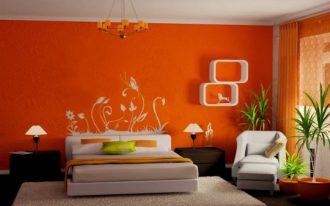 orange painted wall dark wooden floor creame floor rug white painted ceiling white bedframe white chair white shelves orang simple chandelier orange bedroom color warm color for bedroom