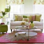 pink rug round glassed coffee table white upholstered sofa floral curtain colorful cushion traditional design style room