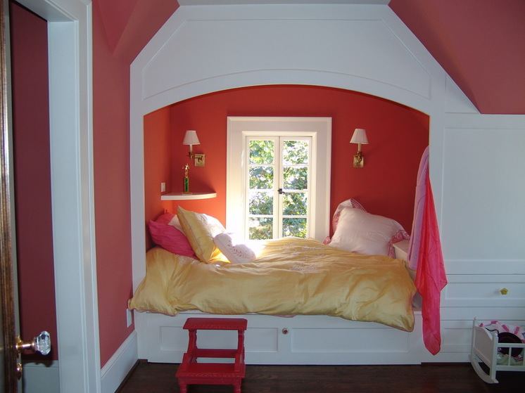 Convert Your Gloomy Attic into an Alluring Bedroom HomesFeed : pink wall pink chair white framed window white and gold sconces white wall mounted shelf white bed frame yellow gold bed sheet pink white pillow hardwood flooring gold pillow from homesfeed.com size 746 x 559 jpeg 96kB