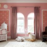 Playful Nursery Room With Elegant Pale Pin Wall Decals Also Interesing Large Twin Windows With Elegant Dark Brown Armchar And Interesting White Crib With Decorative White Fur Rug