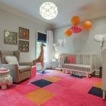 Playful Nursery Room With Pink And Gray Color Accent Also Interesting White Craddle And Enchanting Large Pink Fur Rug With Magnificent Round Pendant Lampt Also Decorative Girrave Doll
