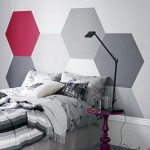 purple side table black arch table lamp grey wall unique headboard with geometrial paterned painted wallwhite grey and black striped blacnket light grey floral bedding set
