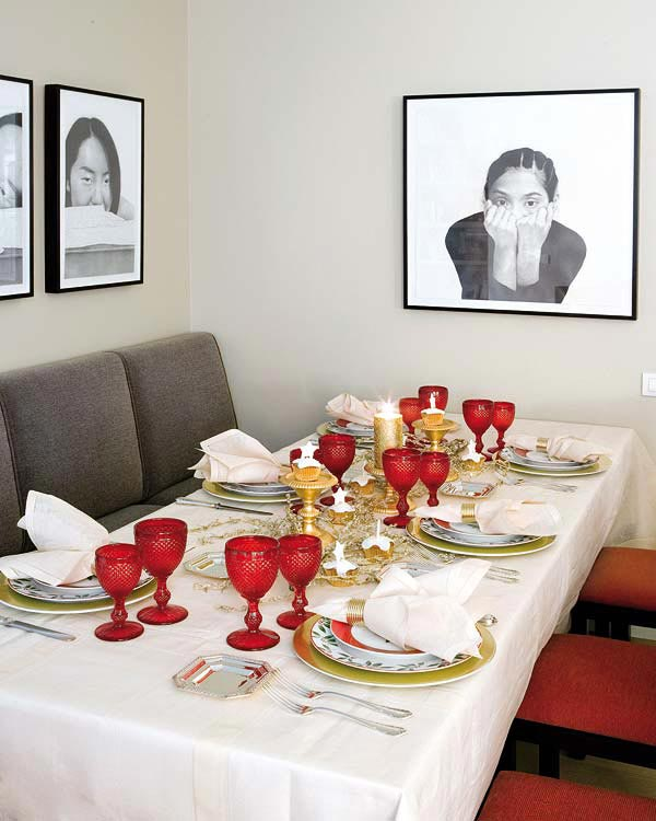 Red Dining Shairs Grey Long Chairs White Wall Glasses Table Cloth Gold Candelabra