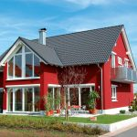 red painted house white painted window and glass panel frame gray roof beautiful modern farmhouse small balcony well groomed grass outdoor sitting area color for house exterior
