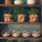relaxing dusty blue wall painting beautiful wood open shelf white bowl with green apple round glass with white candle paper sack with grass