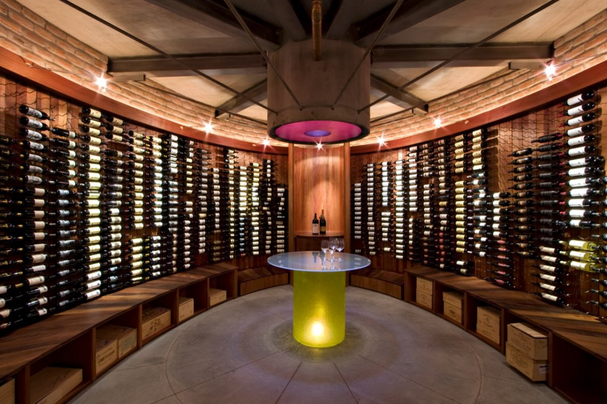 Top three unique artful wine cellars for your bars homesfeed rounded concept wine cellar strong yellow serving table with white tables top modern lamp mini wood arubaitofo Choice Image