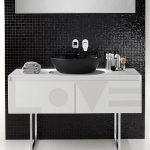 simple black tiled wall with freestanding geometrical patterned storage black vessel sink single faucet gray small towels