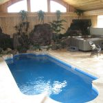 smart small indoor swimming pool with gorgeous landscape and amazing white stone paving with gorgeous spa pool feat eccentric iron armchair