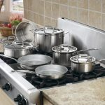 stainless steeled pans stainless steeled stove brown marble countertop brown porcelain tiled backsplash wooden cabinets stainless steleed cookware healthier and greener kitchen