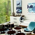 stylish white wall wide window with white frame blue rocking chair white wardrobe with wood counter white bed white bedsheet animal pictures colorful rug blue toy car