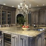 victorian kitchen style with magnificent crystal chandelier also amazing hardwooden cabinet completed with glossy granite top table