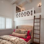 white ceiling white wall white blind white framed window elegant red bedsheet with brown bed frame wood loft stair white loft bed black sconces brown pillow