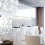 white dining table white dinig chairs white up cabinet white kitchen cabinet with white marble countertop brown curtain white ceiling white wall downlight glass vase