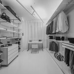 white floor white cabinet white walk-in closet white open shelves silver footwear shelf white chair white desk white curtain downlights white railing lamps