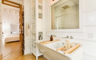 white large sink interesting long cabinet large mirror hang on the wall beautiful wahite decals enchanting wooden door in tile flooring