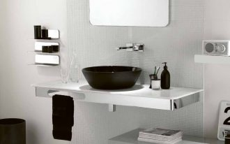 white painted wall black vessel sink black alumunium faucet big patterned glass round edged rectangular mirror black small towel white vintage radio black trash bin
