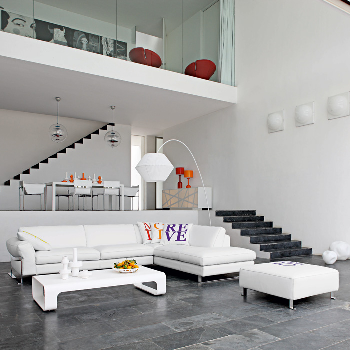 White Painted Wall Gray Porcelain Tiled Wall White Long Sofa White Coffee  Table White Dining Set