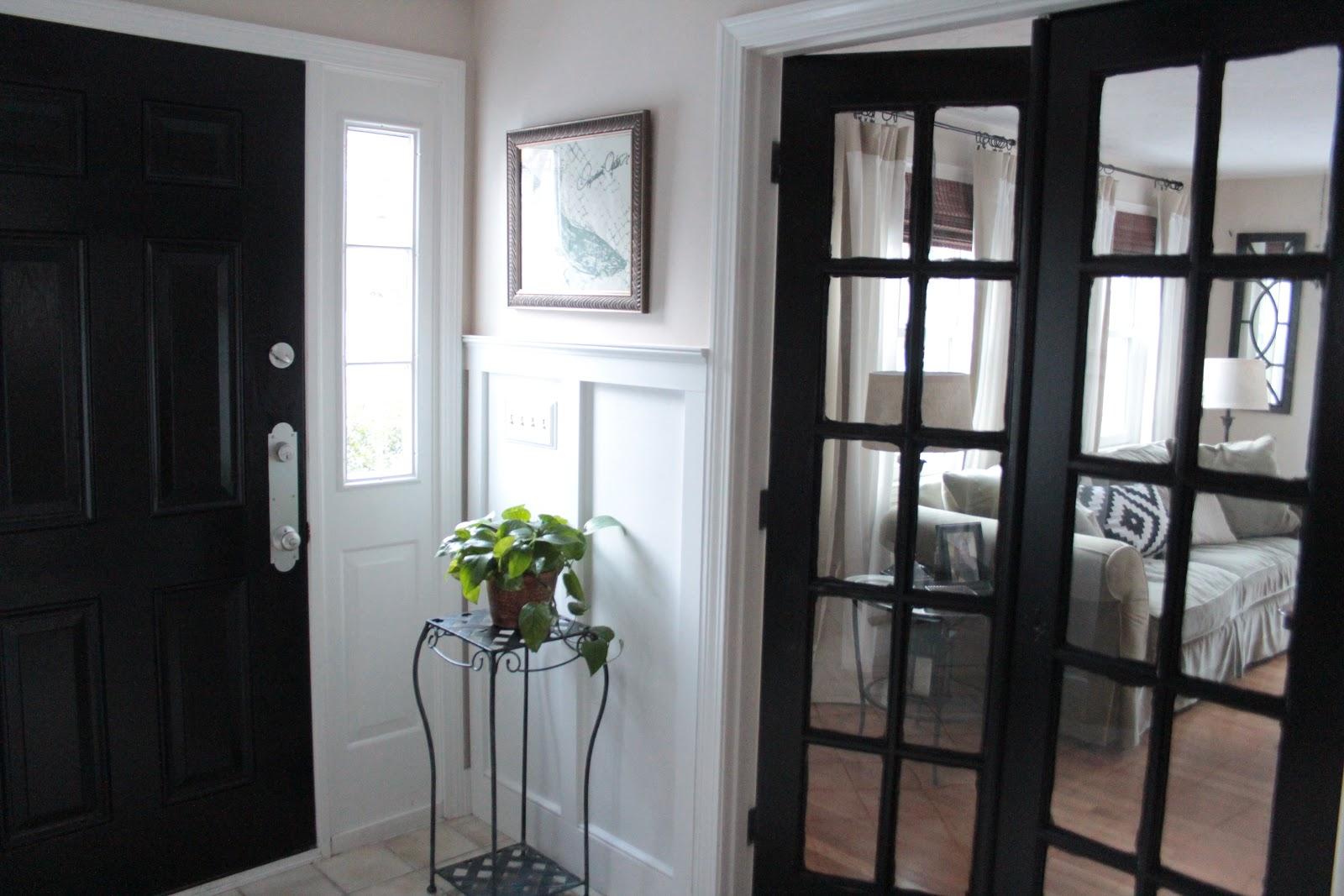 Black painted interior doors why not homesfeed white painted wall white painted glass door white painted main door gray upholstered sofa light wooden planetlyrics Choice Image