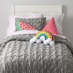 white wall elegant grey statement bedcover white framed bed white dotted pillow rainbow shaped and colored pillow melonwater pillow triangle pink striped pillow