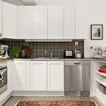 white wooden cabinets black ceramic backsplash black ceramic floor modern wash disher modern electric stove patterned floor rug white painted wall simple modern kitchen design