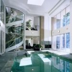 winning indoor swimming pool with large glass window design also interesting granite tile fliiring with amazing half round stair for family hosue concept