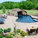 winning inground swimming pool with shotcrete concere also alazing cozy lounge chairs with interesting small tennis table with hardstone paving for open space living concept