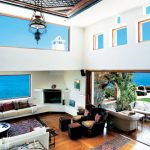 wonderful elounda peninsula hotel with amazing loby area also large glass window design with magnificent window seats and beautiful sea view