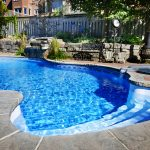 wonderful inground swimming pool with amazing stone patico also interesting iron armchair with magnificent wooden fencing for modern house design