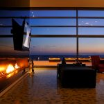 wonderful masculine living room with gorgoeus long panel fireplace and magnificent large glass window outshine beach view with cozy read lounge chair also interesting flower pattern flooring