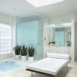 wonderful soft blue shower room with exotic white chairs and open bathtub with large mirror and interesing small cabinet in concrete flooring