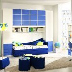 wonderful teenage boys room with buil-tin bed also aamzing large wallmount closet completed with cozy dark blue sofa also small office space with elegant white wall painting decoration