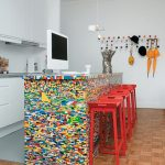 wooden patterned ceramic tiled floor red painted bar stool colorful mozaic kitchen counter and countertop white cabinets white painted wall colorful cute hangers colorful kitchen design ideas