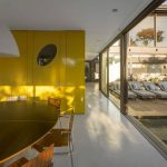 Yellow Painted Wall Large Glazed Panel White Painted Concrete Floor White Painted Ceiling Wooden And Steeled Dining Chair Round Wooden Table Geometric House Limanto Residence In Sao Paolo Brazil