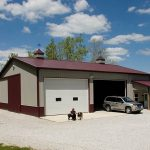 a metal siding barn house with metal proof and big garage