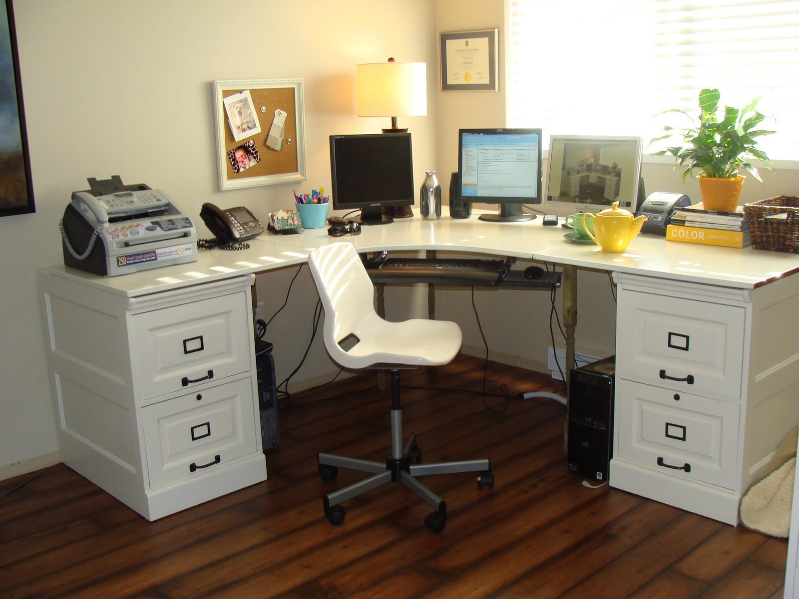 A Pair Of White Wood Cabinets In Desk Office Minimalist Chair Telephone Set Fax Machine
